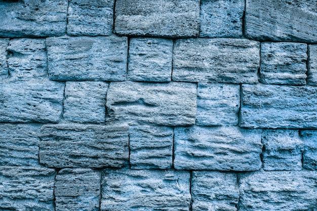 Muro di pietra blu del grunge