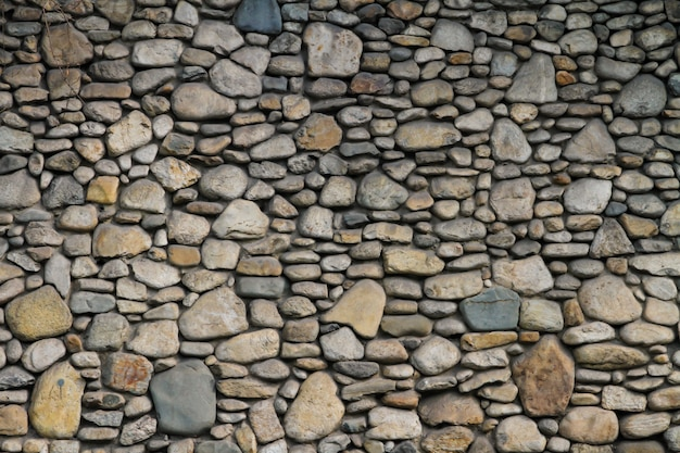 Muro di pietra grigia con bellissimi motivi.