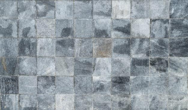 Muro di pietra scuro sfondo di struttura.