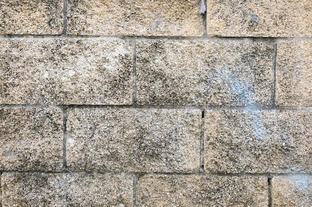 Muro di pietre con superficie ruvida