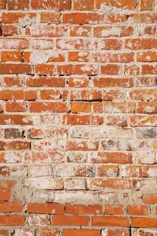 Muro di vecchi mattoni rossi. può essere usato come sfondo o texture.