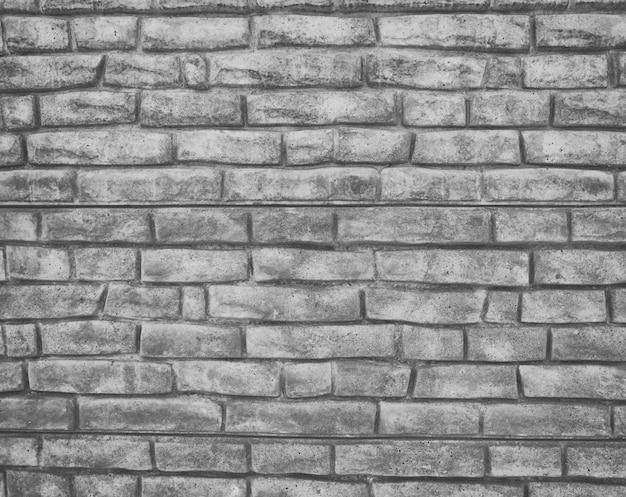 Muro grigio fatto di mattoni di cemento