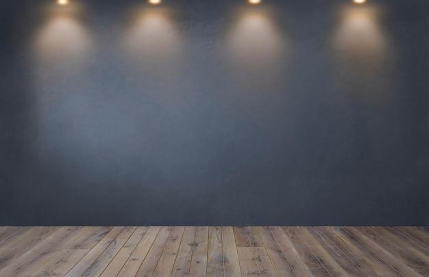 Muro grigio scuro con una fila di faretti in una stanza vuota