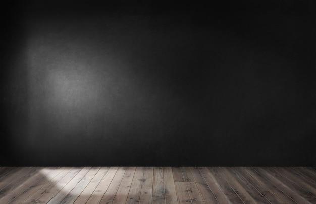 Muro nero in una stanza vuota con pavimento in legno