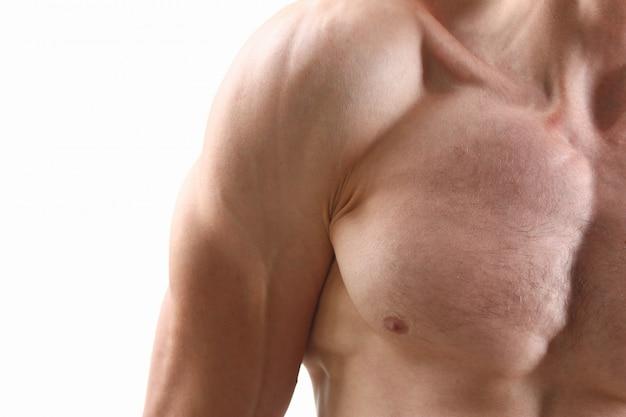 Muscoli pettorali del bicipite della spalla del fondo dell'uomo di forma fisica