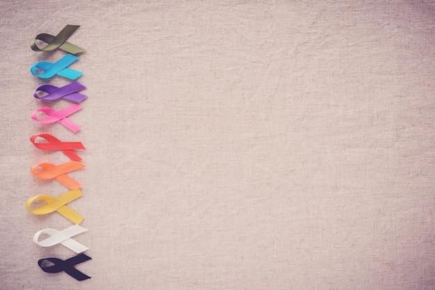 Nastri colorati, consapevolezza del cancro, sfondo del giorno mondiale del cancro
