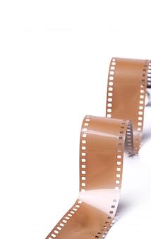 Nastro della macchina fotografica della bobina dell'annata su bianco