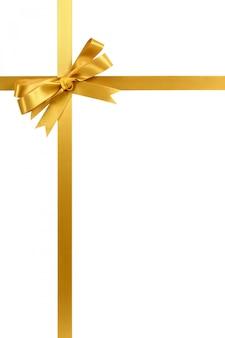 Nastro ed arco del regalo dell'oro isolati sul verticale bianco