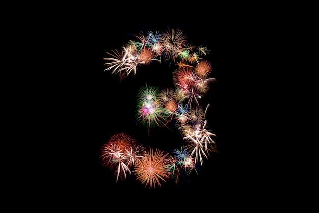 Numero 3. alfabeto numero fatto di fuochi d'artificio reali.