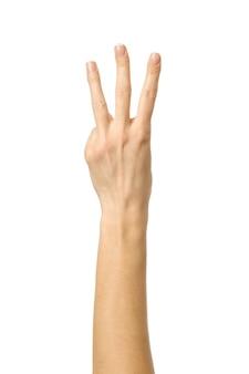 Numero tre. gesturing della mano della donna isolato su bianco