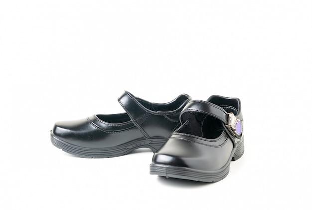 Nuove scarpe dello studente della ragazza di cuoio isolate