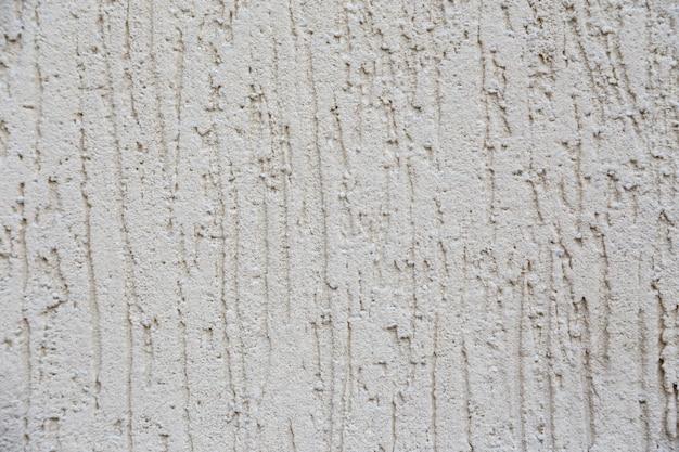 Nuovo muro di cemento bianco. bellissimo stucco in cemento. cemento verniciato. parete di trama di sfondo