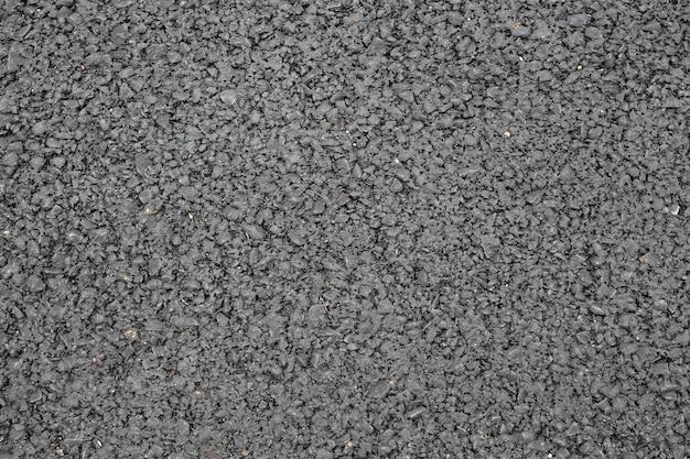 Nuovo sfondo di texture di asfalto grigio scuro liscio.