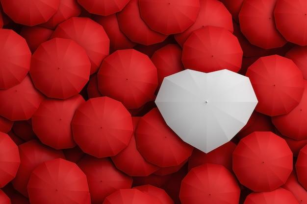 Ombrello bianco a forma di cuore che sovrasta altri ombrelloni