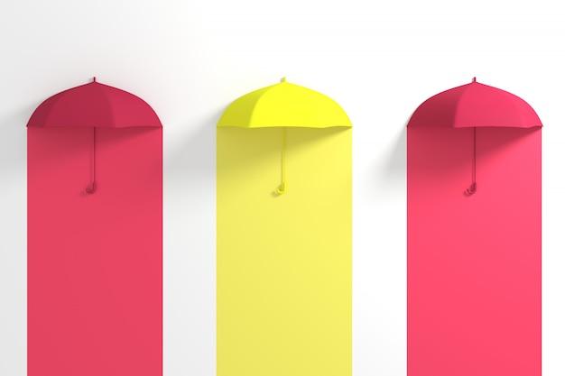 Ombrello giallo che galleggia fra l'ombrello rosso su bianco