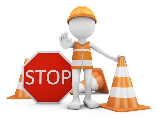 Operaio della strada con il casco e segnale stradale con i coni.