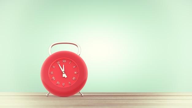 Orologio di colore rosso sul tavolo