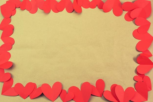 Pagina della priorità bassa dei cuori rossi per il concetto del testo del san valentino