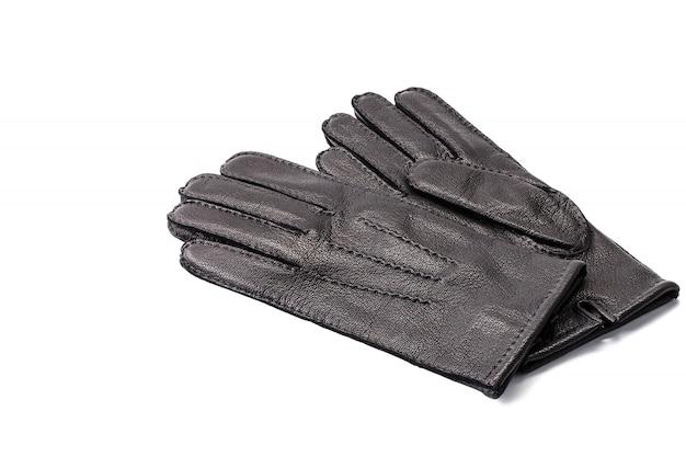 Paia dei guanti di cuoio neri degli uomini isolati
