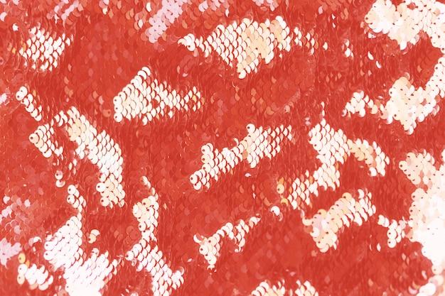 Paillettes astratti che vivono sfondo color corallo.