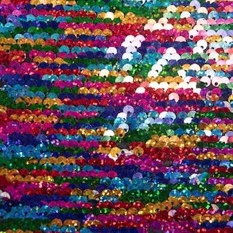 Paillettes multicolori luminosi sullo sfondo