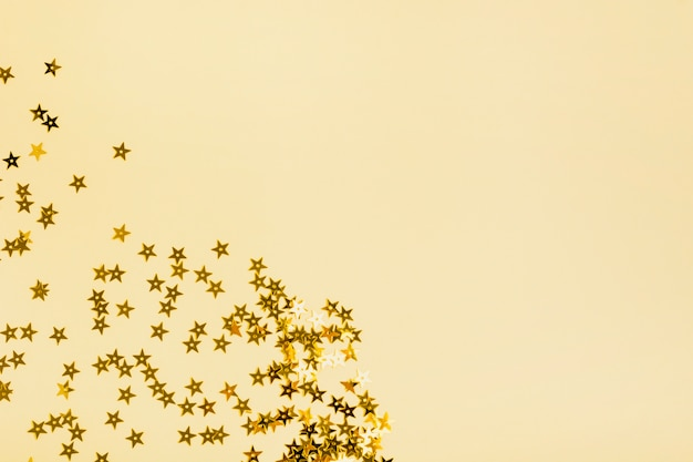 Paillettes stelle dorate con spazio di copia