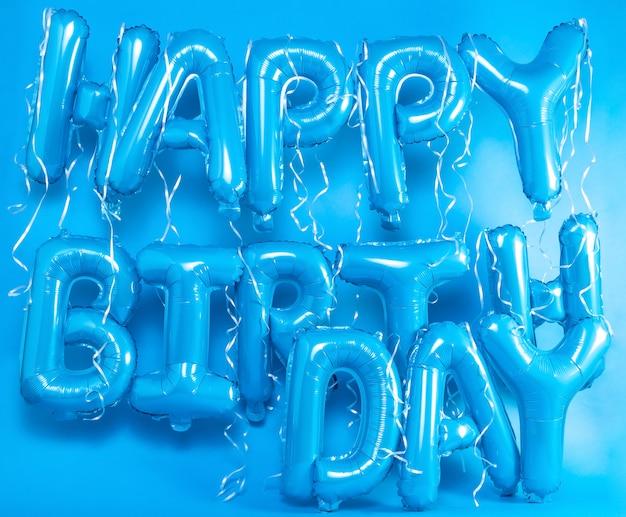 Palloncini lettere buon compleanno su sfondo blu