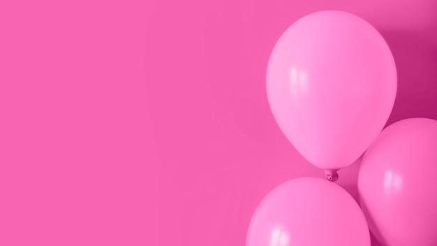 Palloncini rosa con spazio di copia