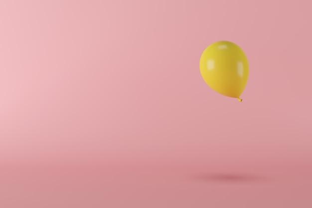 Palloncino giallo di concetto minimo che galleggia sul fondo rosa, spazio della copia