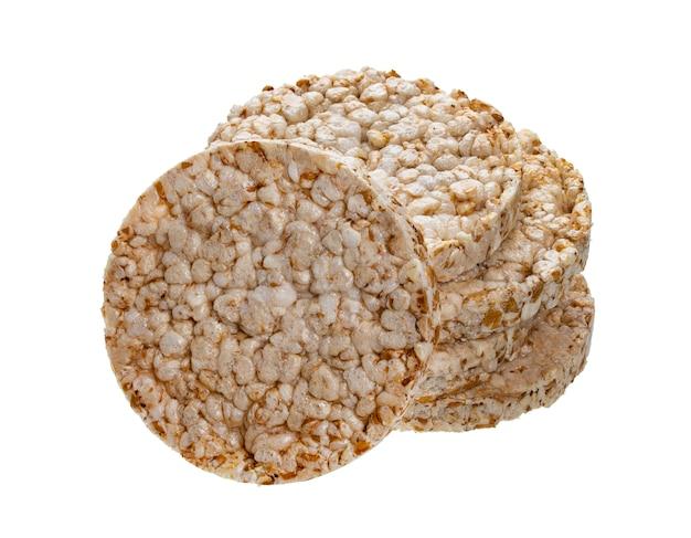 Pane di riso soffiato isolato su sfondo bianco, dieta croccante cialde di riso tondo
