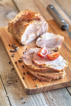 Panino con porchetta - arrosto di maiale italiano