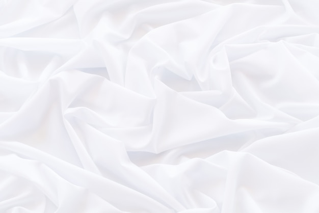Panno drappeggiato astratto bianco, modello e dettaglio scanalato di tessuto bianco per sfondo e astratto