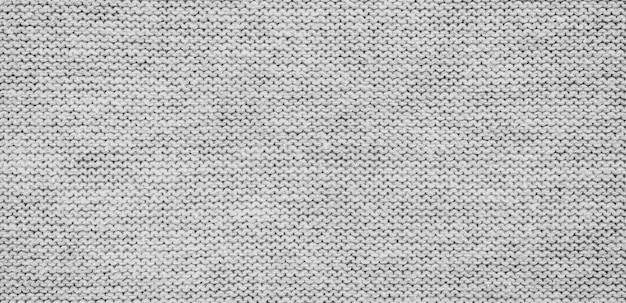 Panorama del fondo e della struttura grigi del tessuto con lo spazio della copia