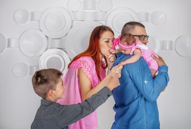 Papà, mamma, sorella e fratello.