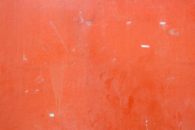Parete arancione del cemento di struttura del grunge. copia spazio