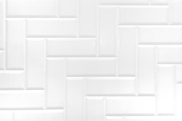 Parete bianca delle mattonelle del mattone ceramico, fondo astratto moderno di struttura.
