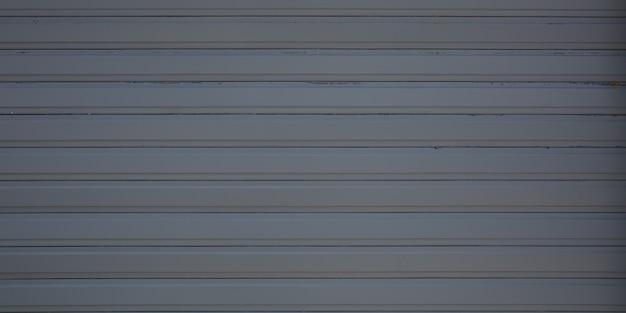 Parete d'argento grigia di stile industriale di struttura del metallo della facciata d'acciaio grigio scuro del fondo