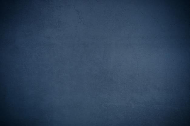 Parete del fondo di vecchio blu strutturato del gesso invecchiato.