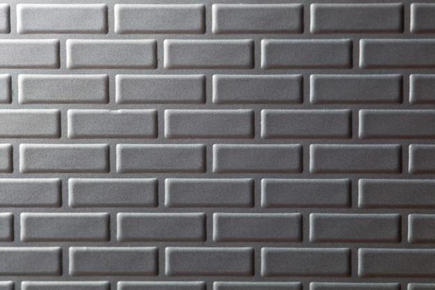 Parete del fondo metallico dei mattoni