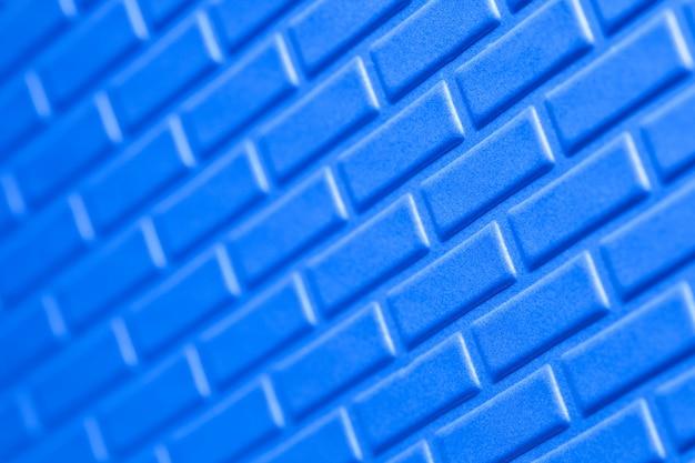 Parete del fondo metallico del blu dei mattoni