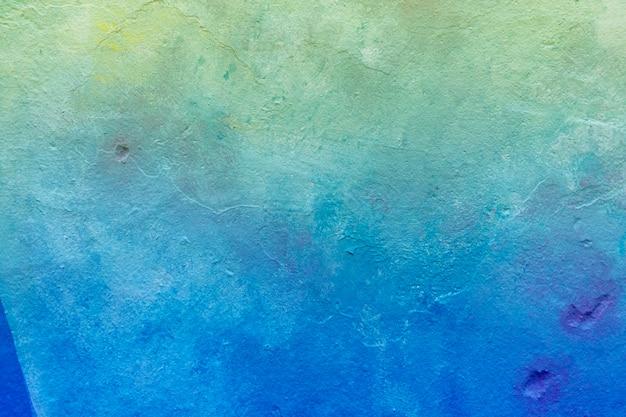 Parete dipinta di tonalità di colore blu-chiaro astratta