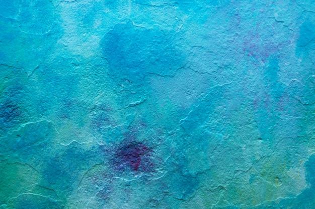 Parete dipinta di tono di colore blu astratto