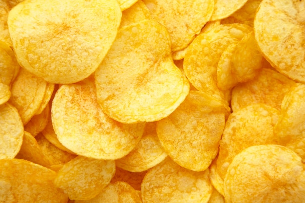Parete dorata delle patatine fritte con lo spazio della copia per testo