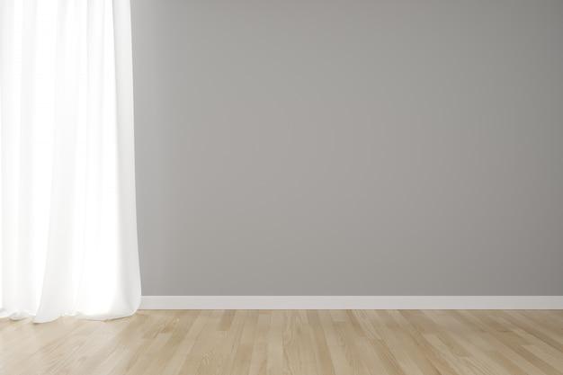 Parete grigia interna vuota con tenda bianca sul pavimento di legno.