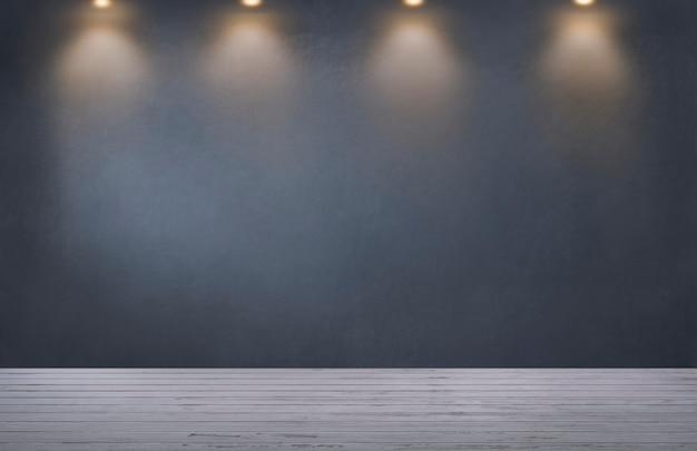Parete grigio scuro con una fila di faretti in una stanza vuota