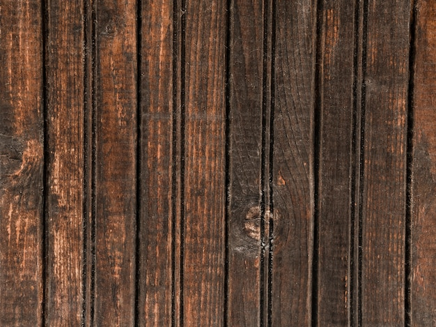 Parete in legno scuro con motivo a trama