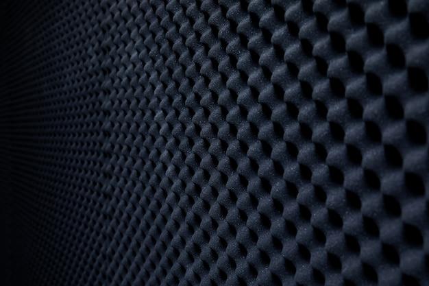 Parete insonorizzata nello studio del suono, fondo della spugna assorbente del suono