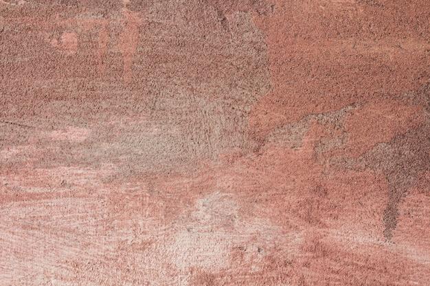 Parete rossa di struttura astratta come fondo d'annata