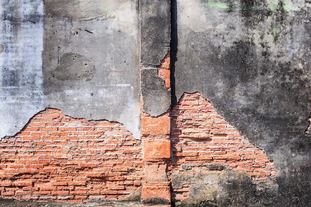 Parete strutturale del blocco di mattoni della pietra strutturata architettonica marrone-rosso invecchiata d'annata