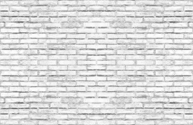 Parete strutturata del vecchio mattone bianco sporco per interior design d'annata di tono leggero.